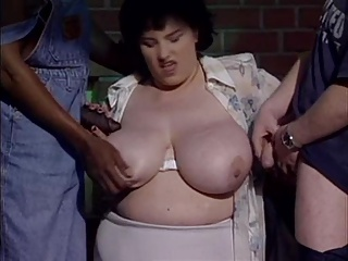 Very busty mom takes two cocks