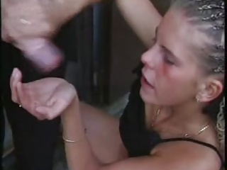 Skinny blonde jerks guy off into her hand and licks it up