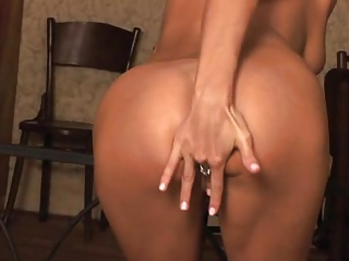 Blond girl playing with her body and 1 toy