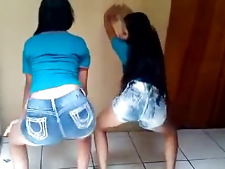Two teen latinas dancing