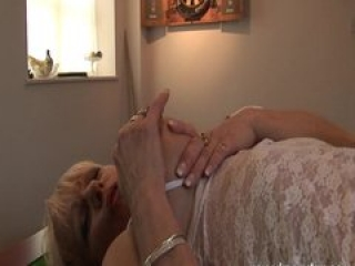 UK mature pornstar Jane Bond plays with her pussy on a pool table